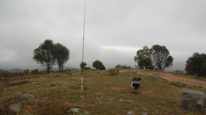 operating site at Mt Stromlo north hump.  Antenna is a 5 metre centre loaded vertical over a 4 wire ground plane